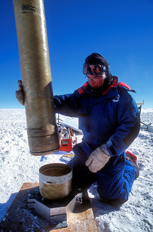 [RodriguezWell-LoweringTube5.jpg] Lowering the casing tube into a drilled hole in order to create a Rodriguez well, Dome C, Antarctica. HDR image created from several scans of the same slide in order to compensate for bright snow.