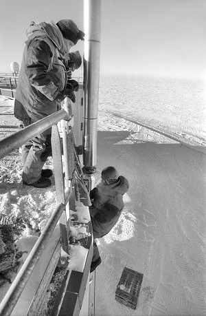 [RappelFixingExhausts-BW.jpg] In Antarctica when shit hits the fan, it takes even more effort to clean the mess. Quite literally in that case, condensation in the exhaust pipe of the bathroom waste burner had frozen and clogged, resulting in an evil smell in the station and the need to 'go' outside. Jeff and myself took turns installing heaters and insulation on the pipe while rappelling off the roof of the building in harrowing conditions. It's windy up there.