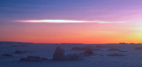 [PSC.jpg] A polar stratospheric cloud see from Dumont d'Urville, a rare and impressive sight above the winter icebergs.