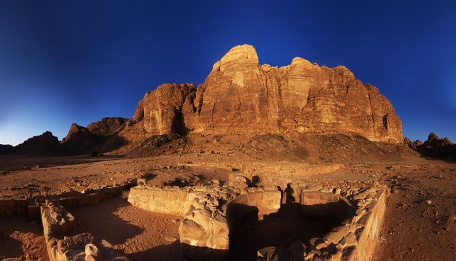 [20111104_070915_NabateanTemplePano_.jpg] Panoramic view of the Nabatean temple and the east face of Wadi Rum as sunrise.