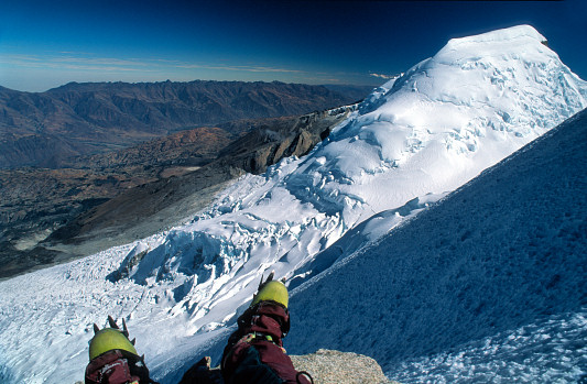 [Escudo.jpg] Peru, my second expedition and time of my biggest mountain solos. After we took turns being sick at various base camps, I felt like a lion soloing a vertical km of 60° ice in a few hours. On top a lone rock offers the first rest of the last 2 hours of repetitive hammering. And an impressive sight.