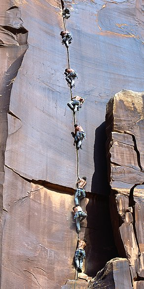 [SuperCrackJasonSequence.jpg] Sequence showing a sequence of a climber on Supercrack, at Utah's Indian Creek.