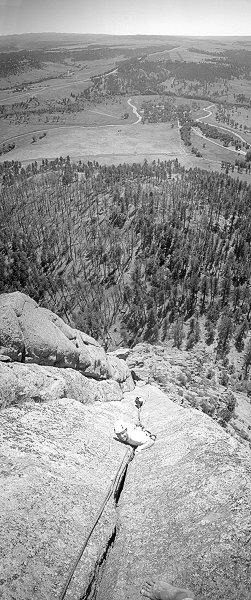 [BW_WaltBailey_VPano.jpg] Vertical panorama (2 vertical pictures) of Max and Jenny on Walt Bailey Memorial, an excellent hand crack on Devil's Tower, Wyoming.
