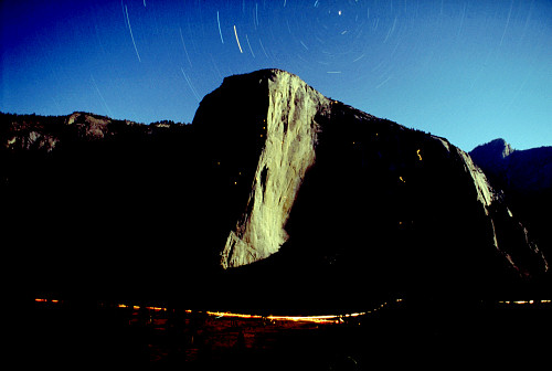 [ElCapMoon.jpg] El Capitan at night, 1 hour exposure, 50mm/f1.8 at 5.6. The headlamps of the climbers leave a trail of light. It takes some power of will to take such a picture: hike up to the proper spot in the evening with the gear and a sleeping bag, set it up and take a bunch of picture as the night gets darker, increasing the exposure each time: 30s, 1 minute, 3, 10, 30, 1 hour, 3 hours... The non-reciprocity of films in dark conditions makes it so that doubling the exposure does not double the amount of light on the film. Bring an alarm clock.