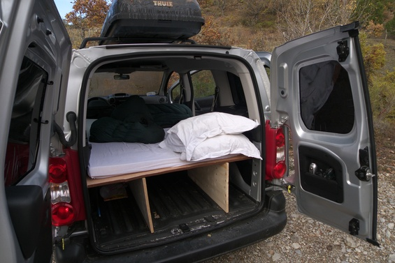 a view of the back of the car with the bed