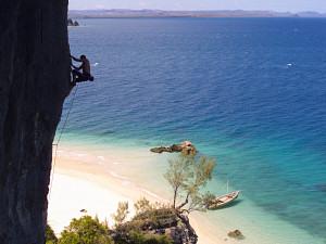 Climbing 'L'iles au tresor' (6b+) on the island of Nosy Anjombalova