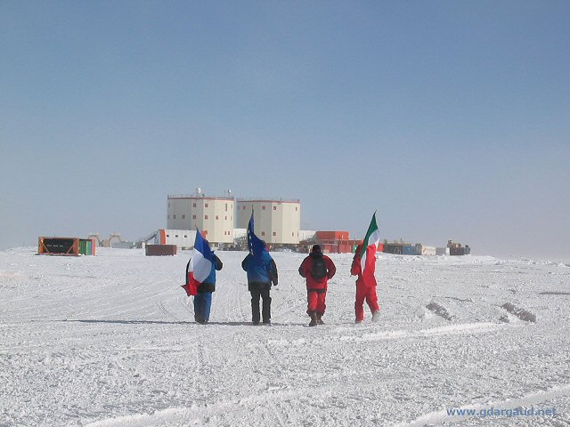 [ConcordiaFlags.jpg] Flag bearers walking back to Concordia minutes after the departure of the last plane.