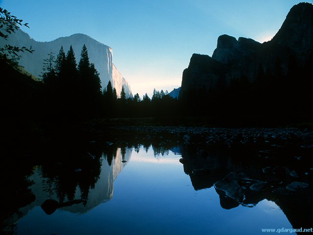 [ElCapMerced.jpg] El Capitan reflected in the Merced river, Yosemite.