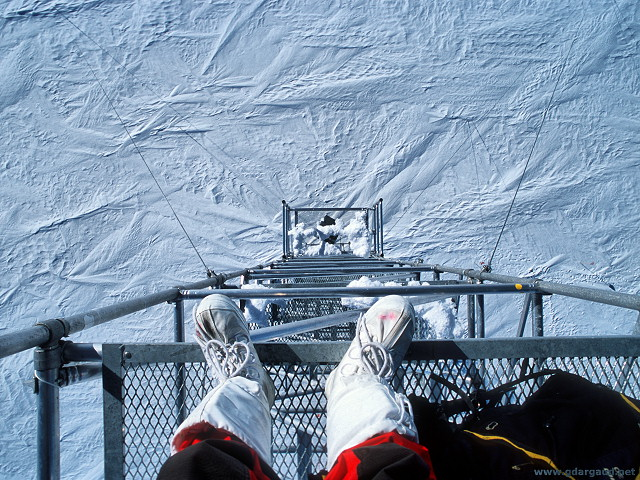 [LookDownFromMast.jpg] Looking down at the high polar plateau from a height.