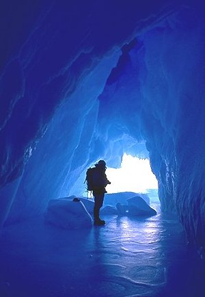 [IceCave.jpg] Visiting an ice cave in an iceberg during my first winterover. The ground was strangely bouncy and elastic, due to seeping seawater.