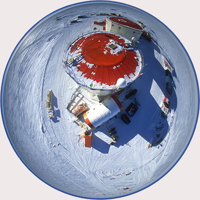 [DomeC-Aerial4FH.jpg] Aerial view of Concordia. I attached the camera, pointing vertically down, to two tethered helium balloons normally used to launch radiosondes into the higher atmosphere. I let the balloon carry the camera to about 50~80 meters, using the timer delay to trigger. In this case I used the fisheye lens not for the 'round effect', but for the fact that previous trials had shown it was very hard to control the direction and the framing of the shot. In this case, if it points more or less down I'm sure the building will be in the shot.