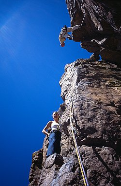 [Golden.jpg] Jenny and Lisa merging vertical perspective while climbing in Golden, Colorado. 20mm.
