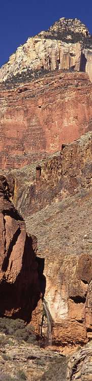 [RibbonFallsFar.jpg] This is simply a vertical picture of Ribbon Falls, on the north Kaibab Trail of Grand Canyon, cropped into a panorama. Notice that the cropping induces a drop in sharpness compared to assembled panoramas.