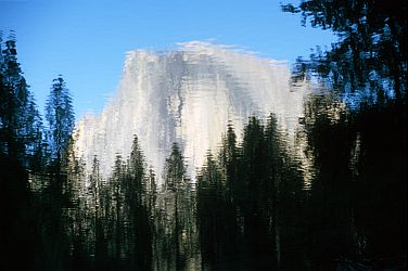 [HalfDomeReflection.jpg] It's so hard to capture the majesty of Yosemite in picture that I just decided to get the reflection of it and let you imagine the rest...