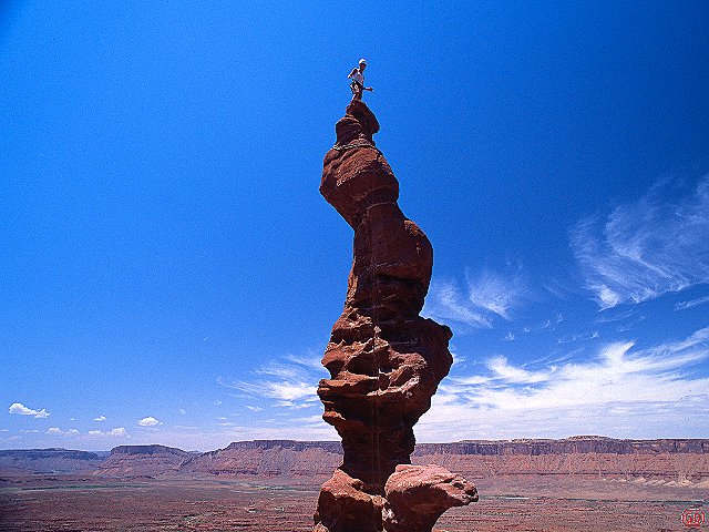 [CorkscrewH.jpg] Jenny on the demented corkscrew summit of Ancient Art, Utah