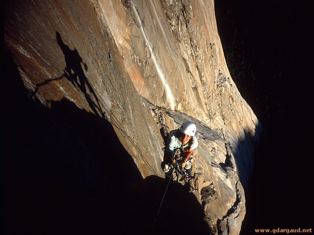 [SalatheHeadwallH.jpg] Jenny reaching the headwall of the Salathé Wall in the sunset, El Capitan, Yosemite