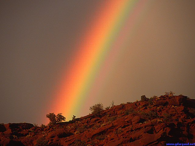 [UtahRainbow.jpg] Classic, but still very nice, bright rainbow on very dark background above the Utah desert, 2003.